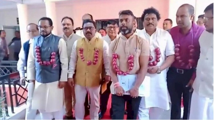 Assam Congress MLAs wear onion garlands protests over hike in Onion price