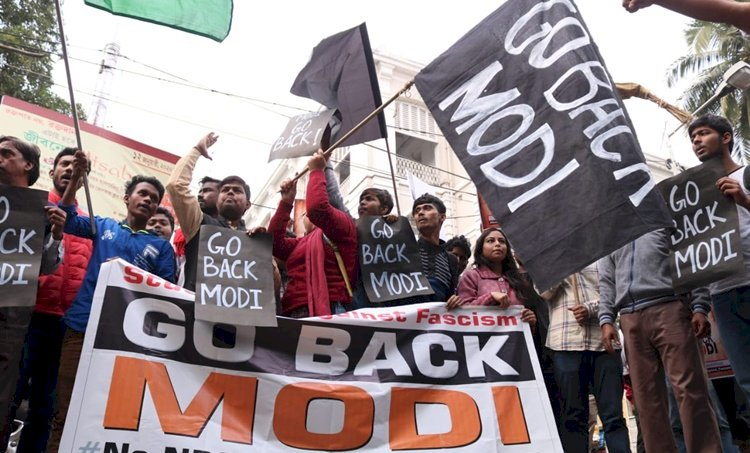 Go Back Modi: Protesting SFI activists carry posters against PM's Kolkata visit