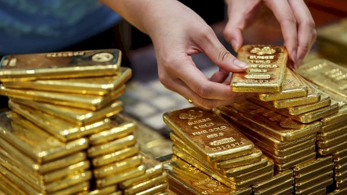 Gold futures traded lower amid volatility