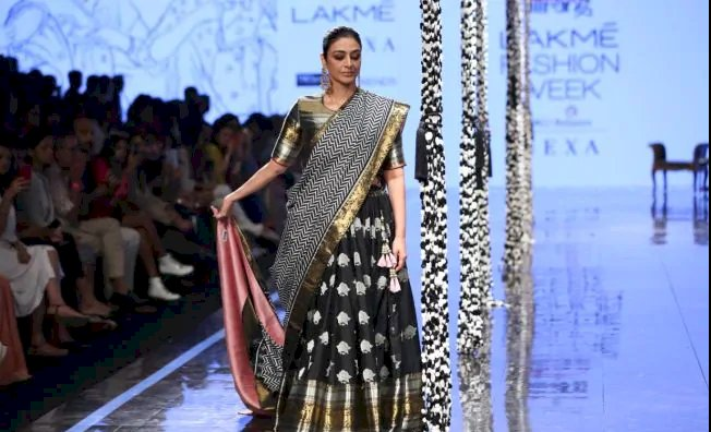 Tabu in a Black And Gold Lehenga at LFW