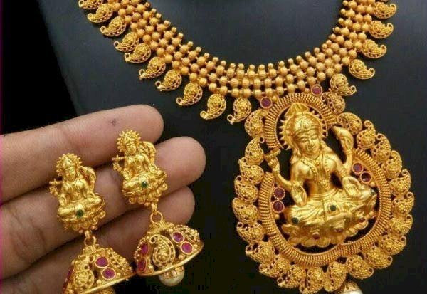 Gold rate pares gains after surging over 1% As Coronavirus spooks equities