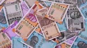 Indian rupee has ended 74 paise lower at 76.37 per dollar