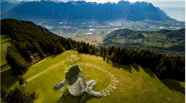 Artist reveals massive coronavirus-themed grass graffiti in Swiss Alps
