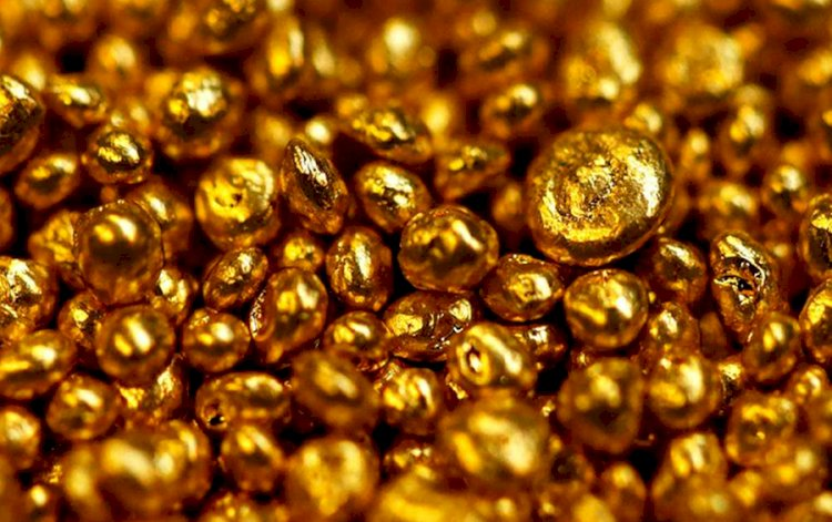 Gold metal trades above Rs 51,000